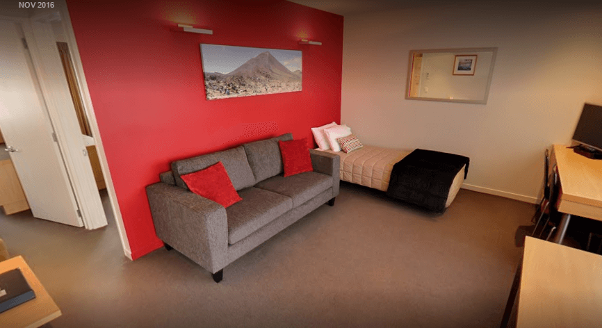 The two bedroom unit has a spacious lounge with a single bed.