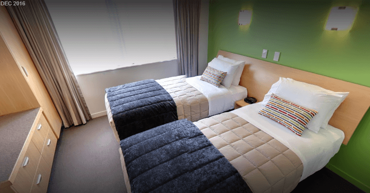 Single beds in 2 bedroom unit